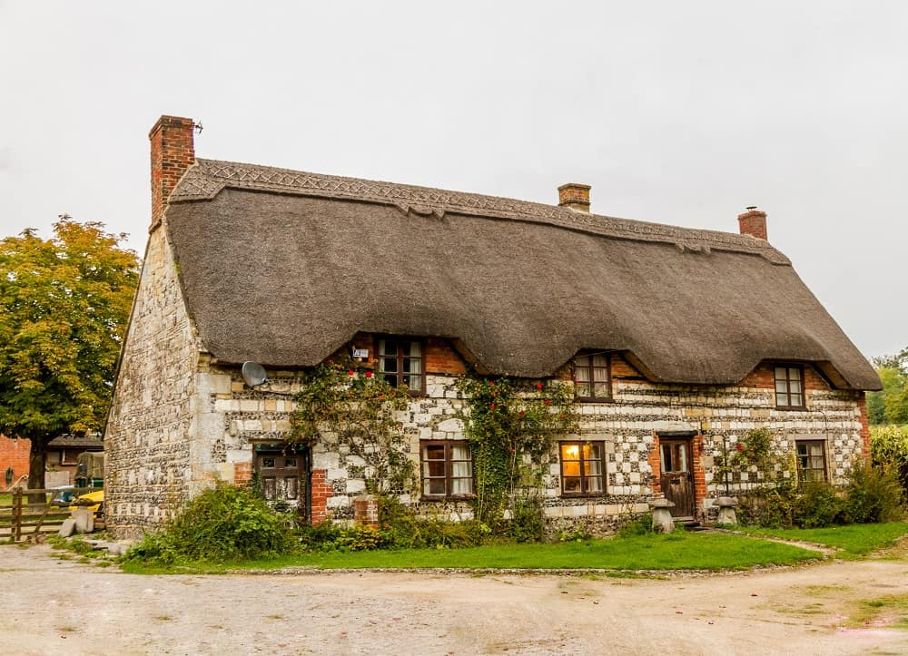 thatched-roof cottage with gingerbread-like feel