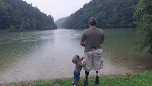 Wounded veteran Jesse Torres and son fishing