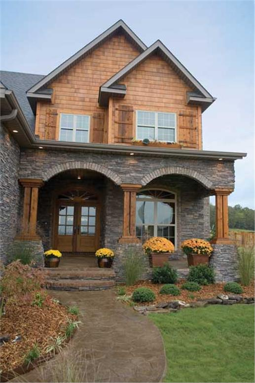 An inviting porch and entry door make this house feel so welcoming.