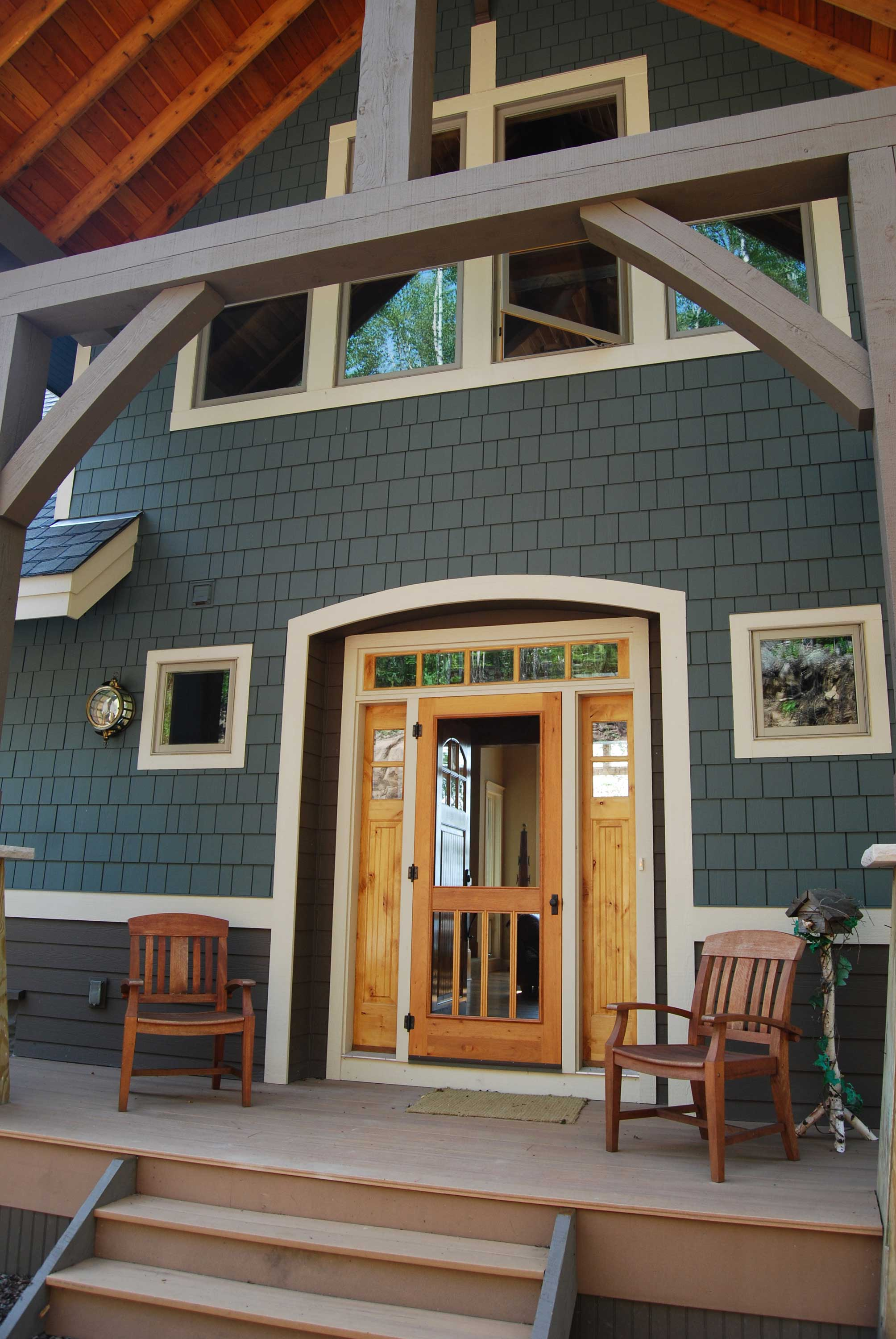Example of transom window over main door entrance to this Craftsman home (Plan #146-2810).