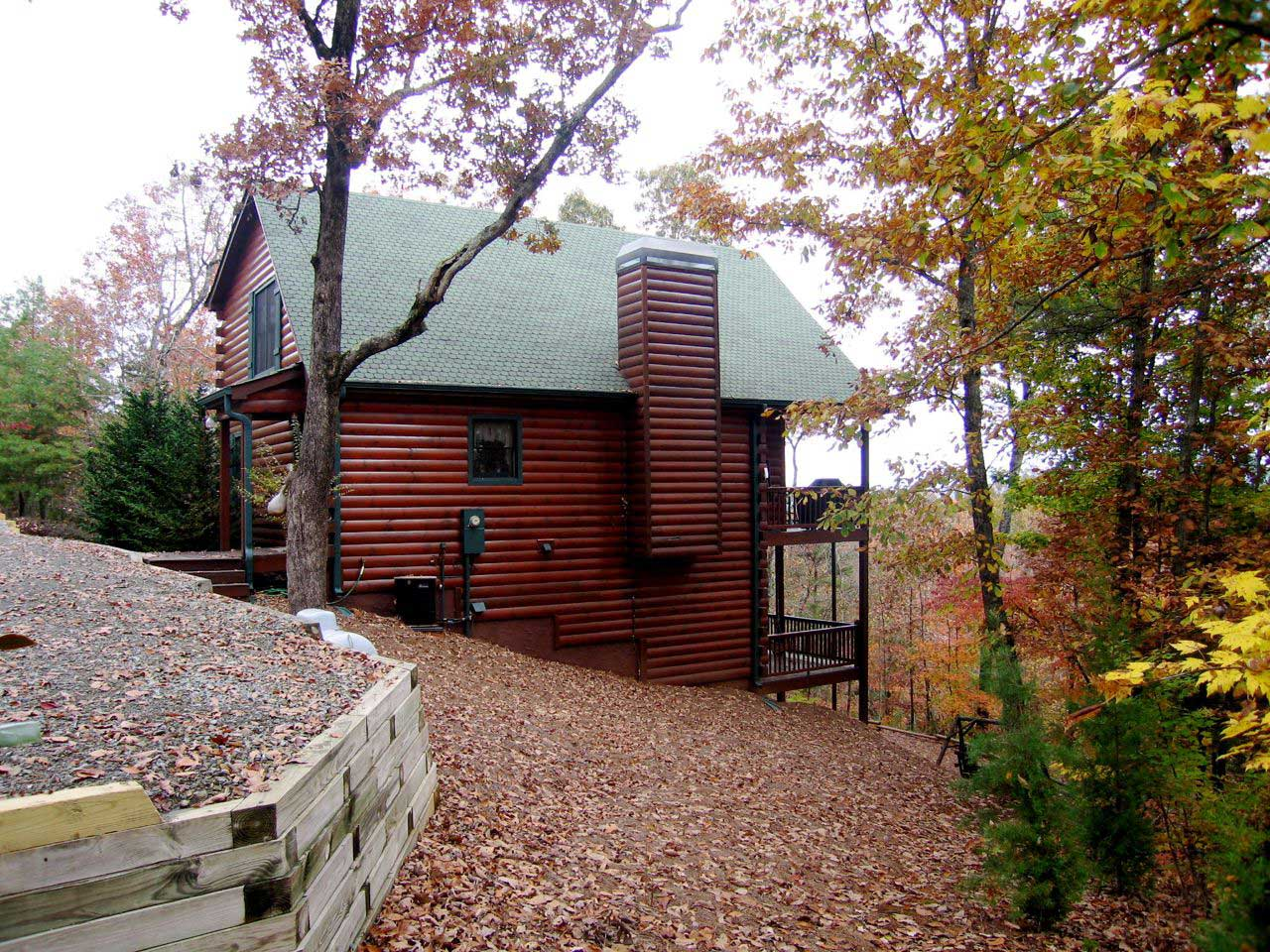 Log Cabin with green asphalt roof and great view of fall foliage