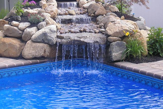 Backyard pool with fountain