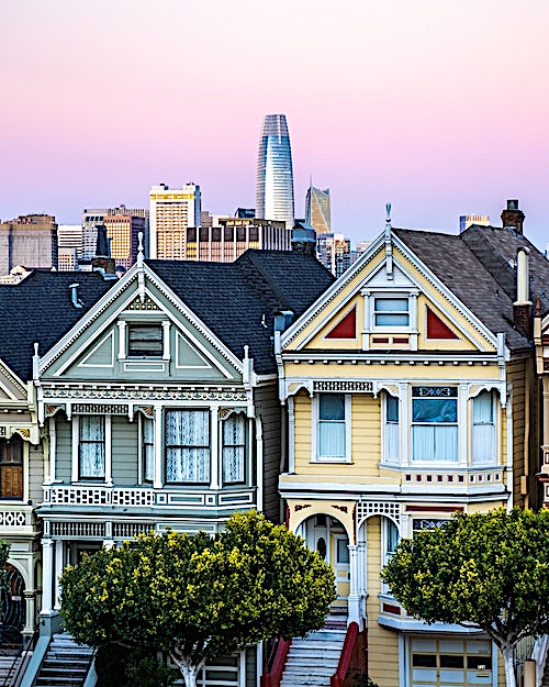 Two homes in Alamo Square Park that display common Painted Lady design elements
