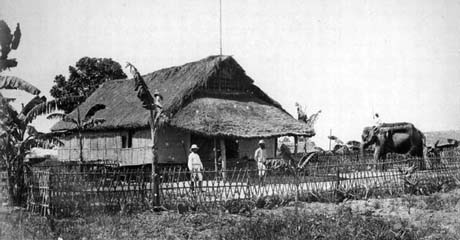 Early bungalow in India (circa 1865) with thatched roof