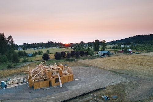 Home under construction in a pastoral setting