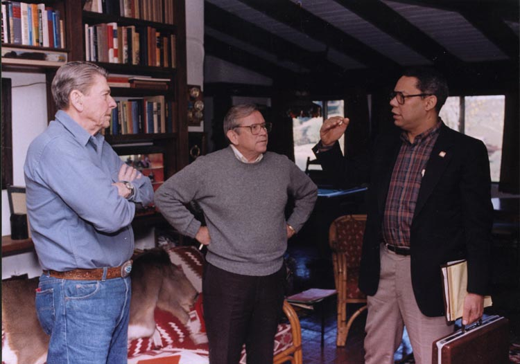 President Reagan speaking with Chief of Staff Howard Baker and National Security Advisor Colin Powell