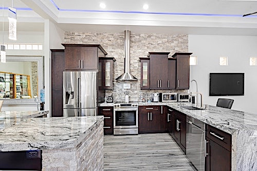 Dark kitchen cabinets with light surroundings