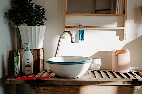 Rustic white bowl sink with teal trim