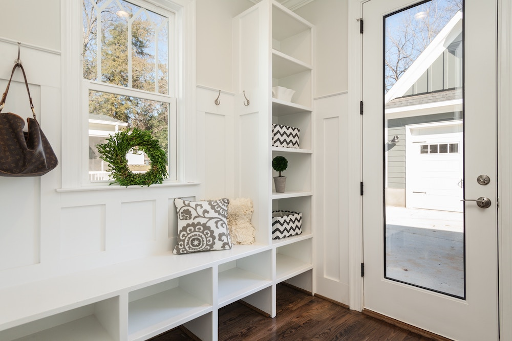 Mudroom with hooks and bins