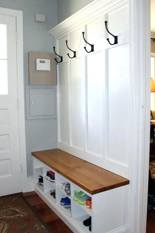 A bench dresses up an entry but is practical, too, especially with coat hooks