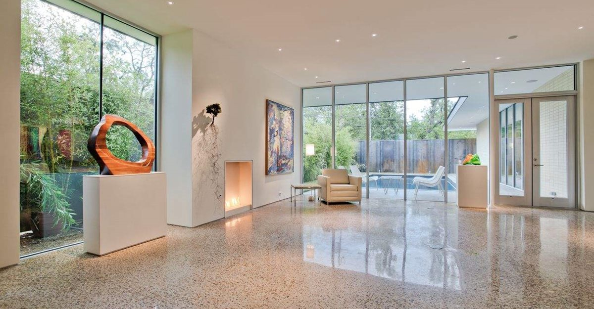 Polished light-colored concrete floor in Great Room of modern home