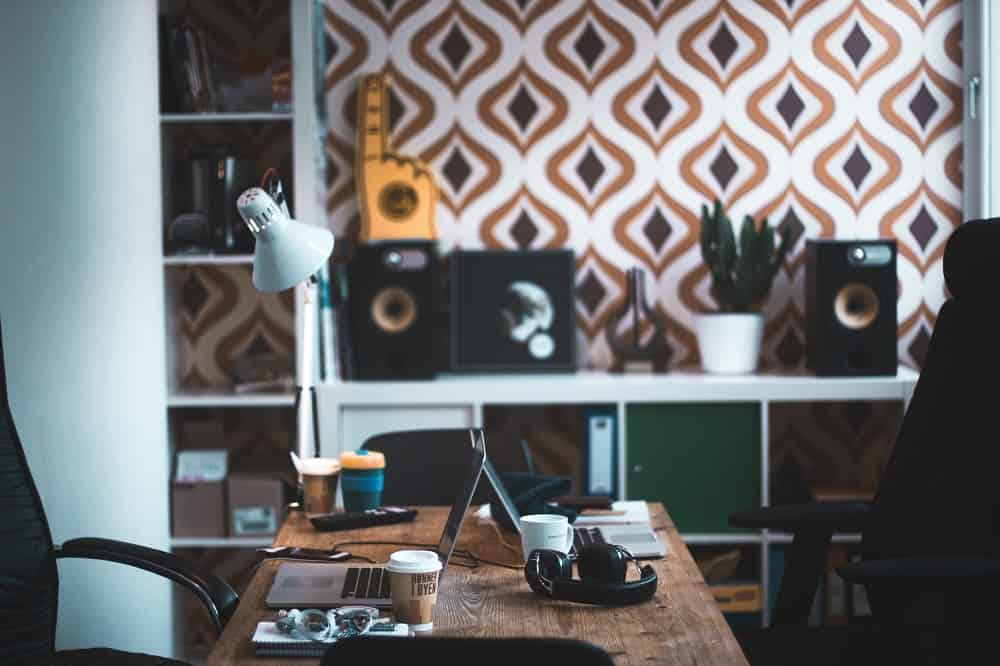Home office with fun wallpaper and decor