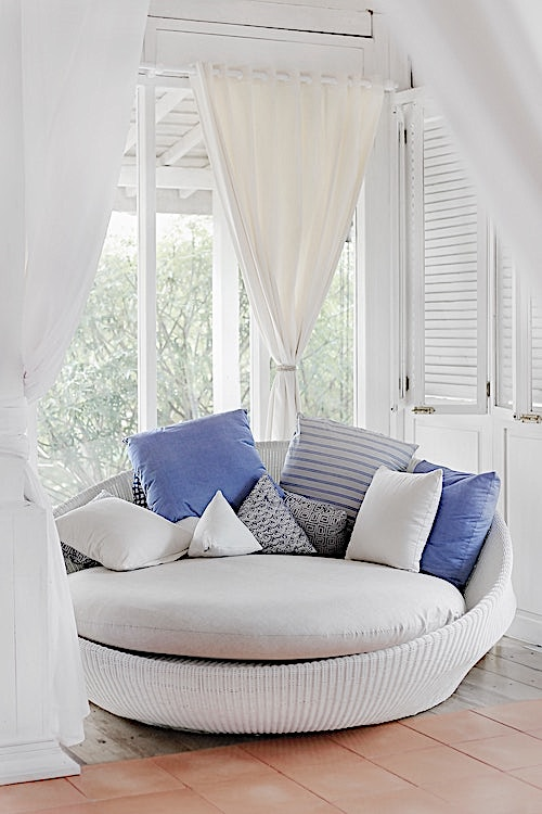 Resting spot in a home with pillows and cushions