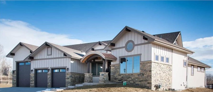 Amazing Country Ranch style home with one two-car garage and one recreational vehicle garage with room for five cars