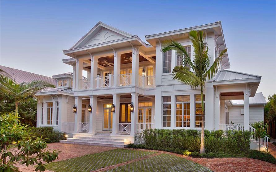 White 2-story-porch Lowcountry home with high ceilings insdie