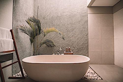 Freestanding bathtub in minimalist, almost zen-like bathroom