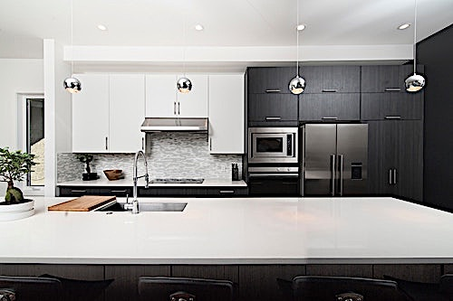 Black kitchen cabinets with white countertops