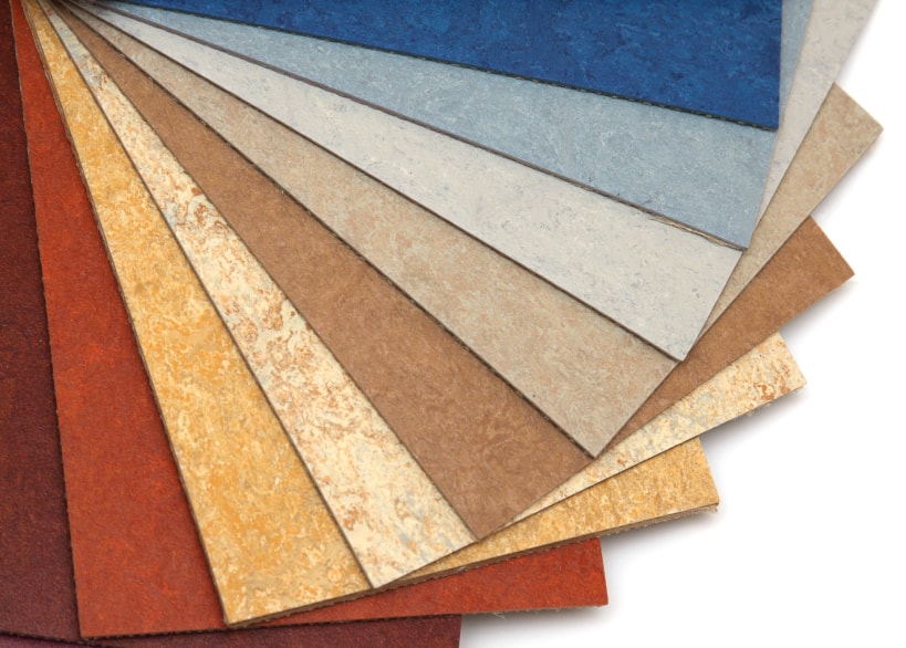 Fan-shaped array of linoleum flooring products in a variety of colors