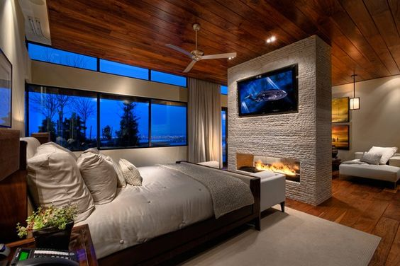 Fireplace and TV in a home's master suite.