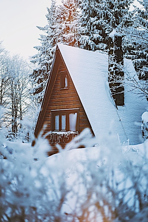 A-frame house in snow