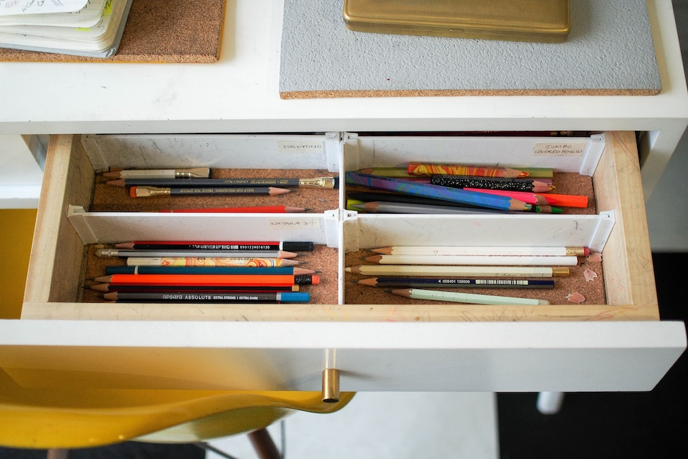 School supplies stored in divided drawer