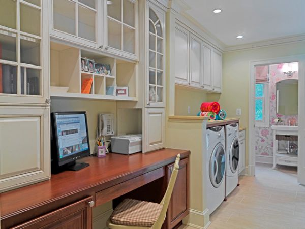 Large laundry room with cabinetry and a desk for office space