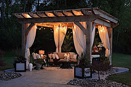 Lights on a deck with pergola and drapes