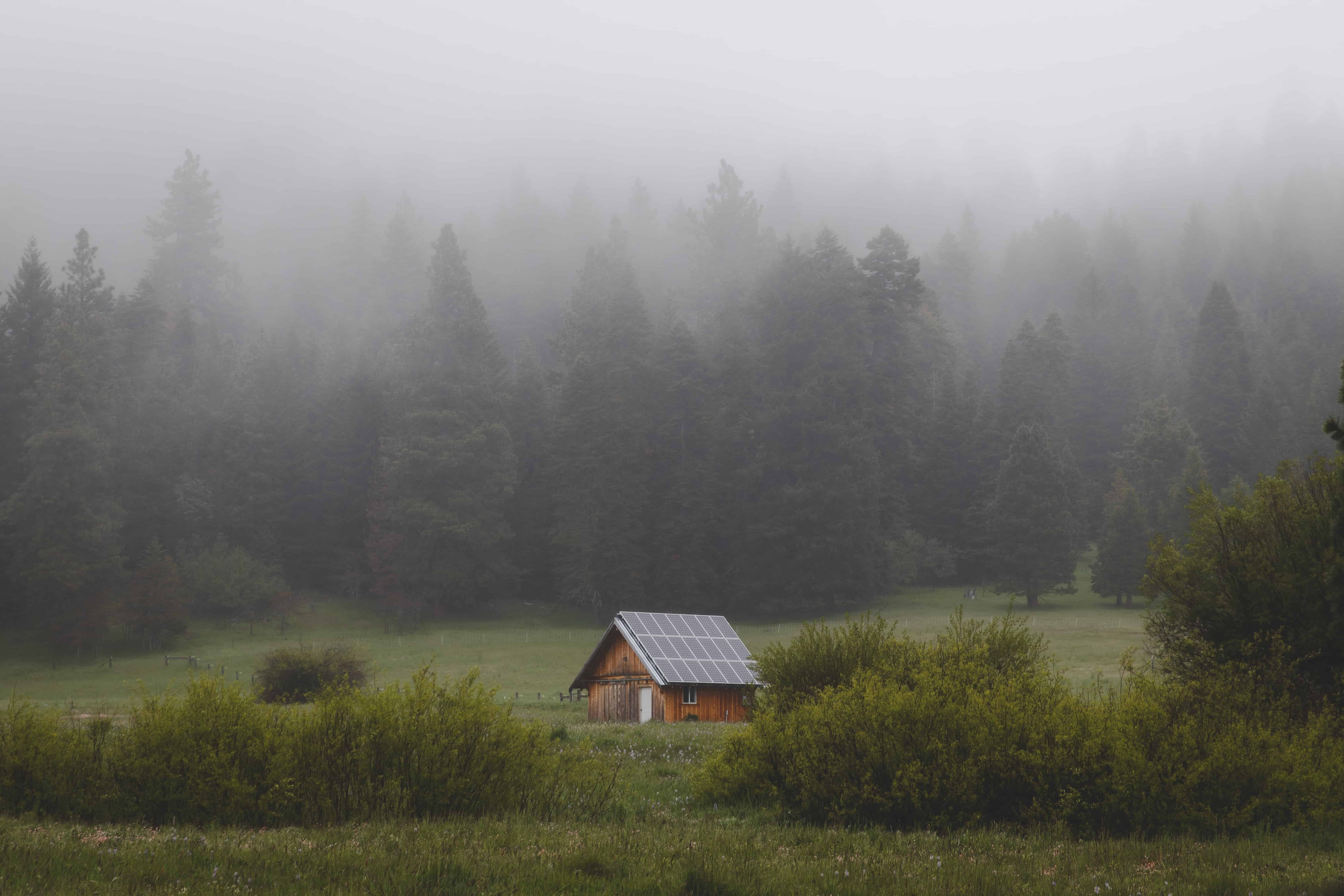 remote cabin in country with solar panels