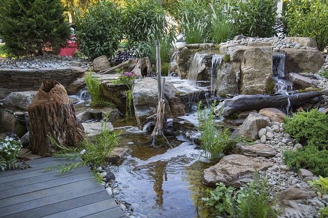 Manmade stream in backyard landscape.