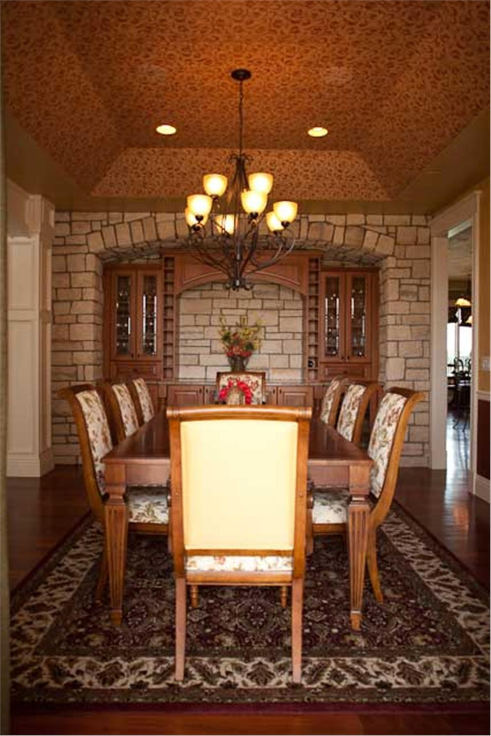 Dining room with upholstered chairs that complement the area rug