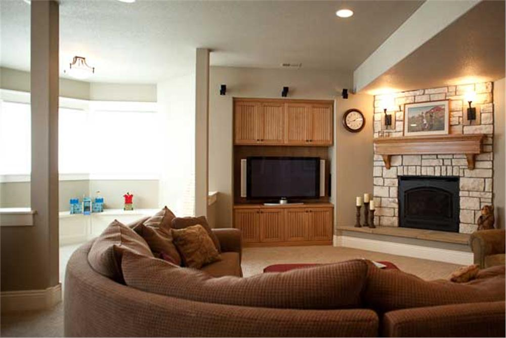 Modern media center with storage cabinets above and below