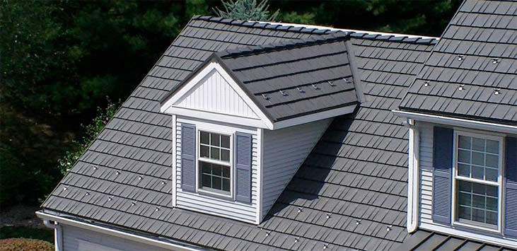 Metal shingles look like stained shake roofing