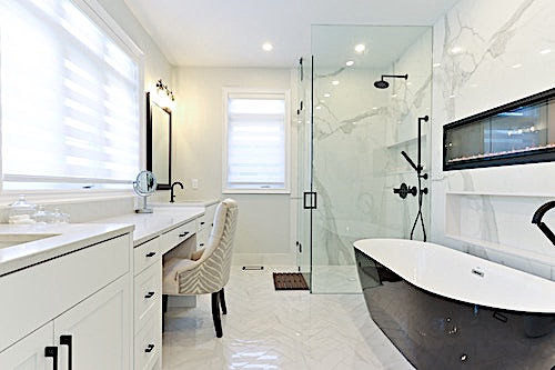 Accessible bathroom with easy-to-get-into tub and roll-in shower