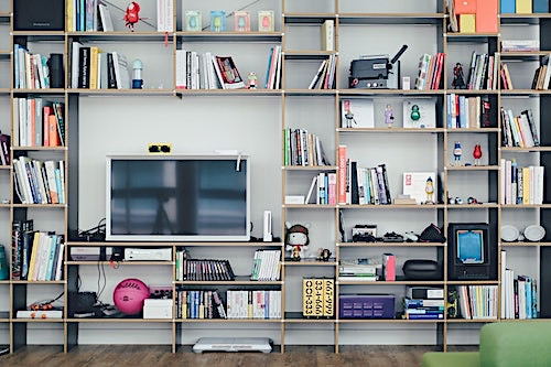 Asymmetrical bookshelf design with TV