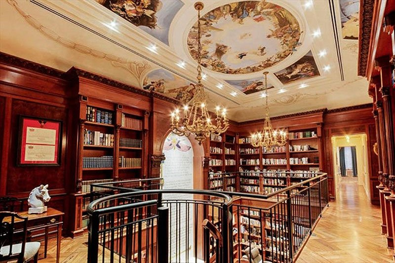 The mansion also has a duplex library with a ceiling mural, chandeliers, and spiral staircase.