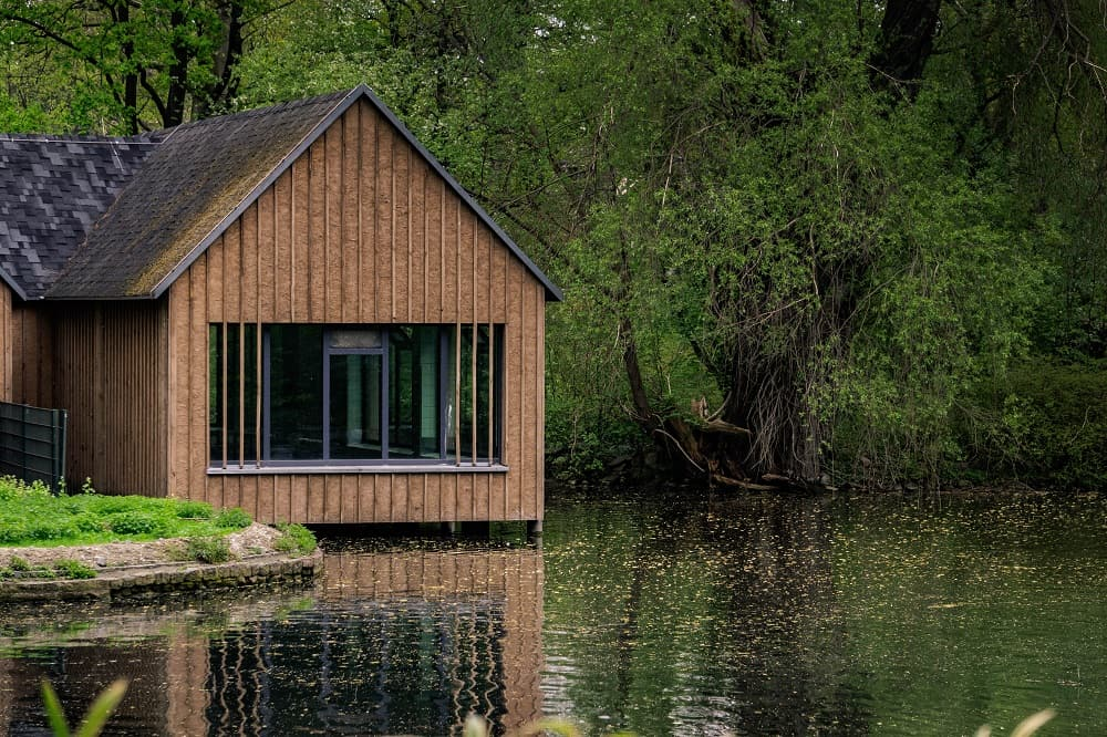 Tiny house on a lake surrounded by trees