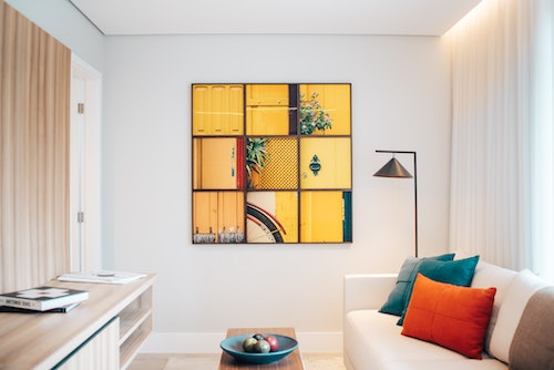 Artwork arrangement as focal point on a living room wall